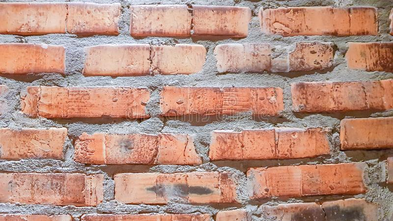 Vintage brick wall background. The red clay brick is beautiful, strong,suitable for decoration as a folk wall, used as a royalty free stock images