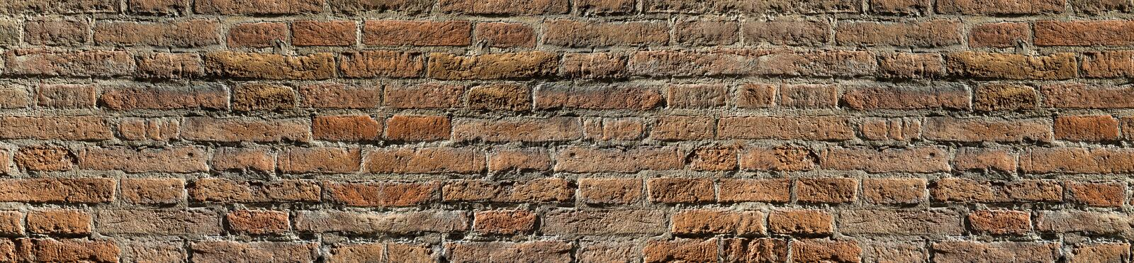 Vintage brick wall texture in contrast lighting for design. Panoramic background for text and image.  stock photo