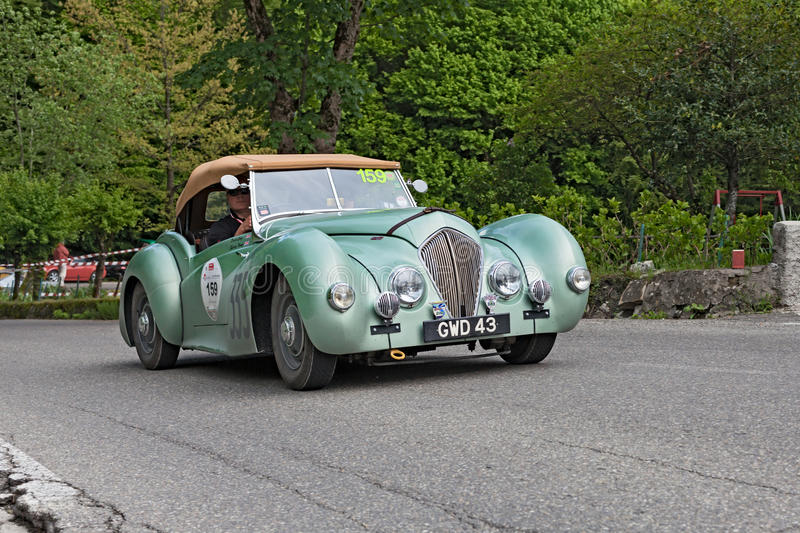 Vintage british car Healey Westland roadster. A vintage british car Healey Westland roadster (1948) runs in rally Mille Miglia 2013, the famous historical race ( royalty free stock photography