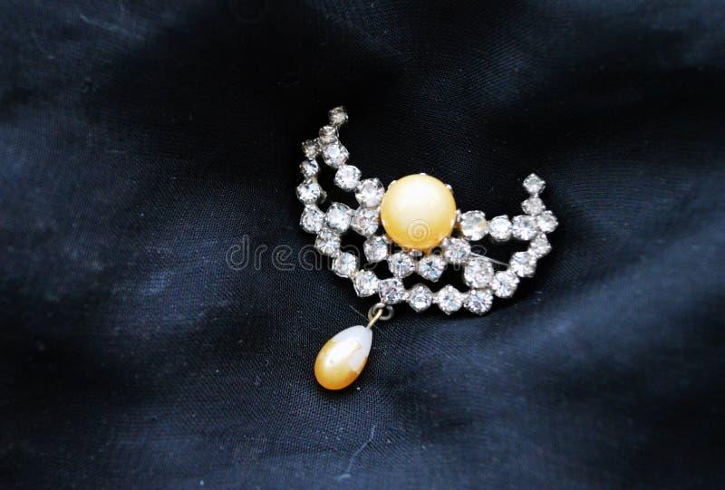 Vintage brooch on black background royalty free stock photo