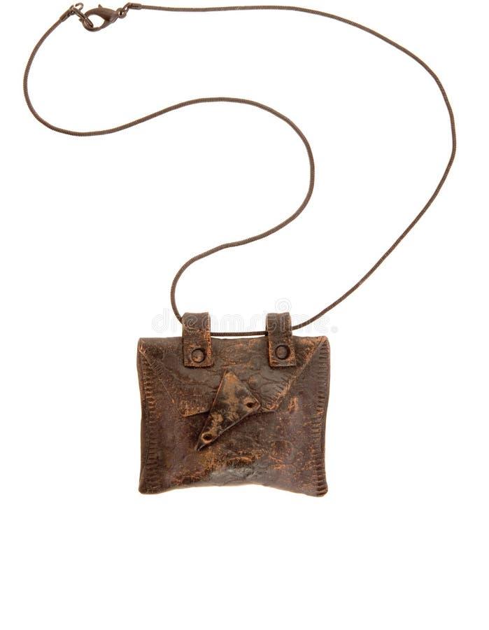 Vintage brown amulet stock photo