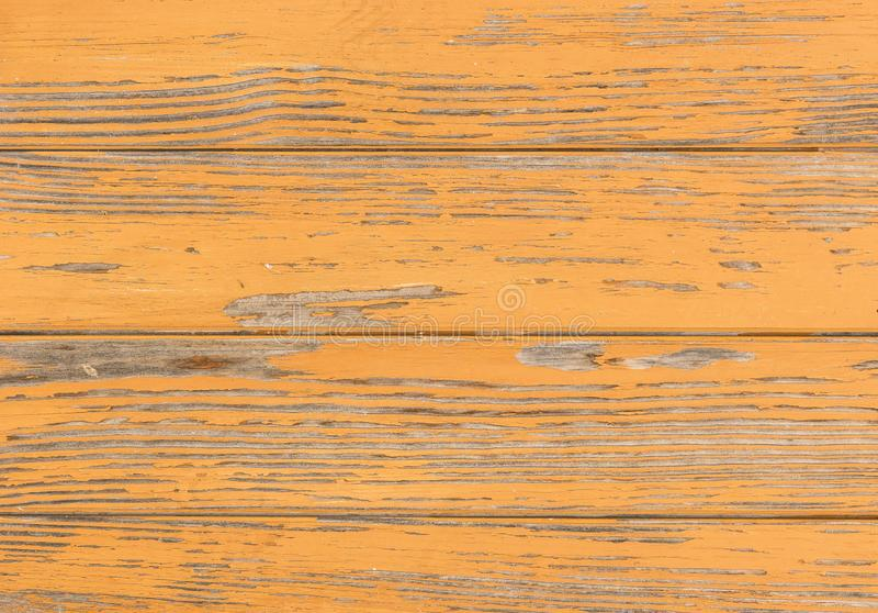 Vintage brown colored wood surface with peeled paint royalty free stock image