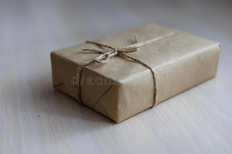 Download Vintage Brown Gift Box On Wooden Background - Filter Processing Stock Photo - Image: 83708532