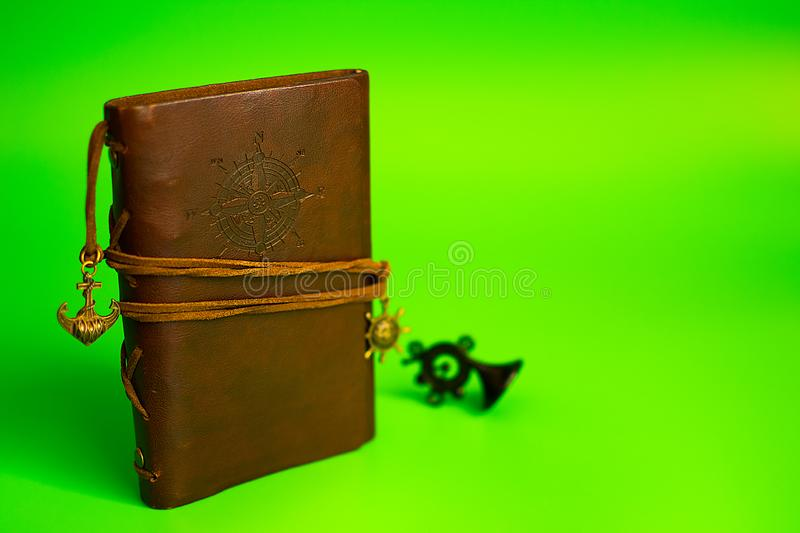 Vintage brown leather note pad. green background. royalty free stock photography