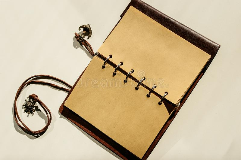 Vintage brown leather Notepad open clean blank sheets of paper stock photography