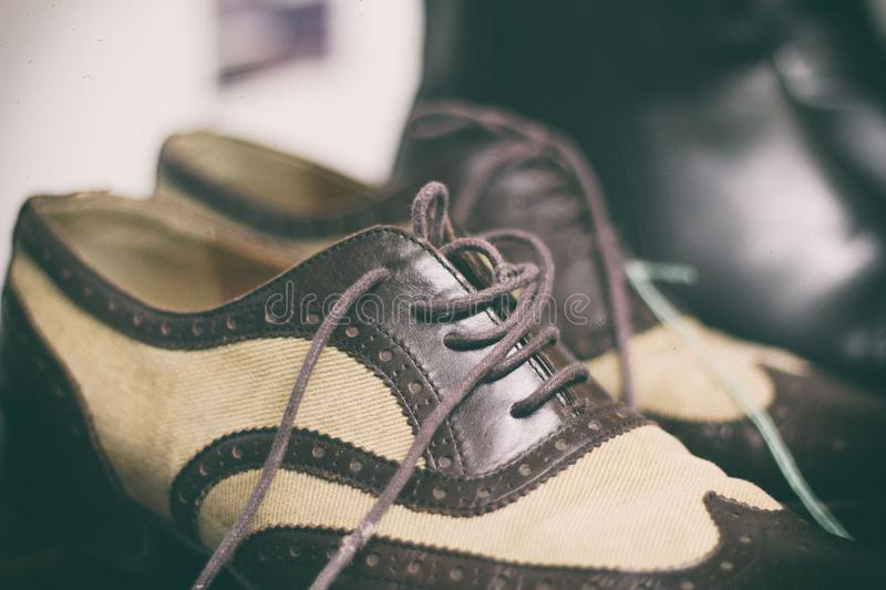 Vintage brown mens shoes. Old fashioned vintage brown leather shoes with untied laces stock photo