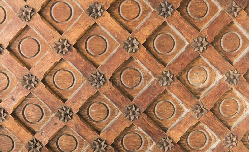 Vintage brown wood texture with metal decoration. royalty free stock image