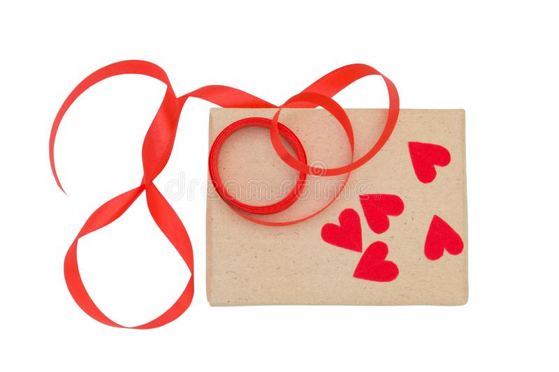 Vintage brown wrapped gift box with red ribbon and heart isolated on white background royalty free stock images
