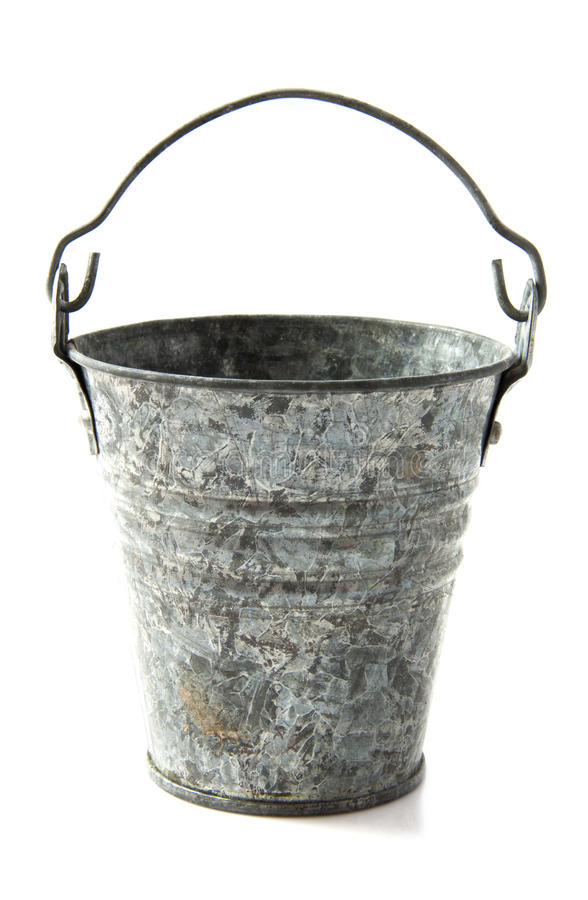 Vintage bucket. Old metal vintage bucket over white royalty free stock photography