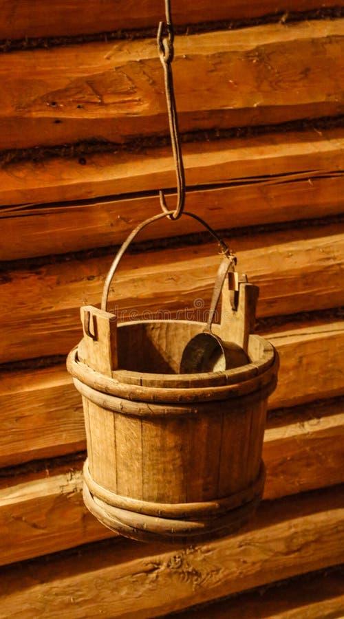 Vintage bucket. Vintage rustic wooden bucket on the hook royalty free stock photos