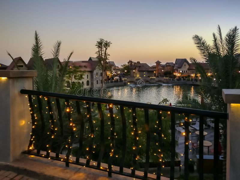 Vintage buildings around a lake - Shot of Dubai parks, Riverland at sunset with a view of its beautiful building design royalty free stock photo