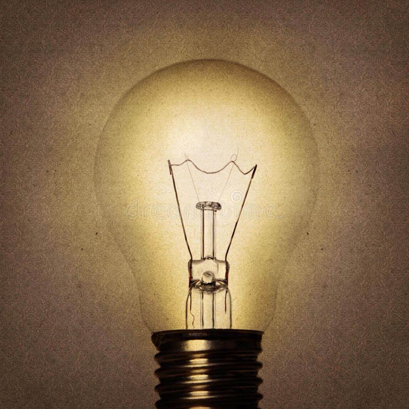 Vintage bulb. On old paper background stock photos
