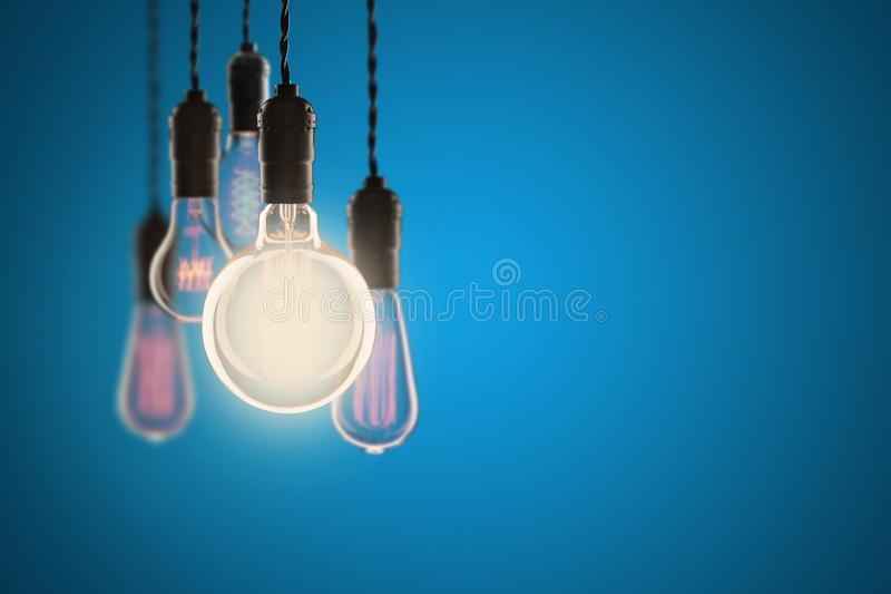 Vintage bulbs on color background - idea, innovation, teamwork and leadership concept. Space for text. Idea and leadership concept Vintage bulbs on color wall stock image