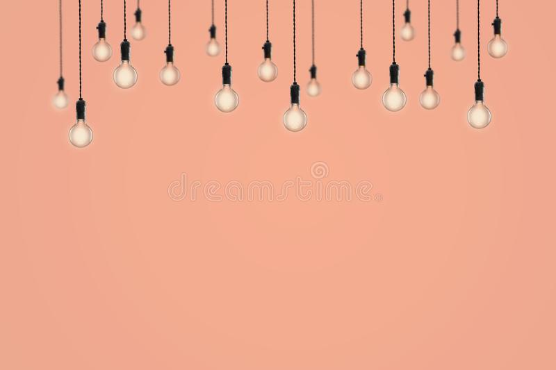 Vintage bulbs on color background - idea, innovation, teamwork and leadership concept. Space for text. Idea and leadership concept Vintage bulbs on color wall royalty free stock photo