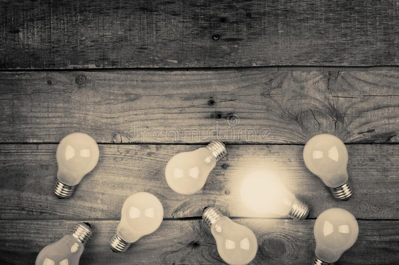 Vintage bulbs on wooden background - idea, innovation, teamwork and leadership concept. Space for text. Idea and leadership concept Vintage bulbs on wall royalty free stock photography