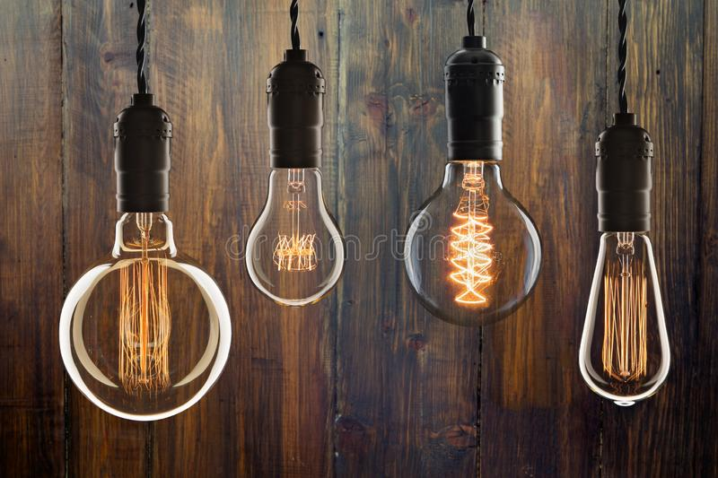 Vintage bulbs on wooden background - idea, innovation, teamwork and leadership concept. Space for text. Idea and leadership concept Vintage bulbs on wall royalty free stock images