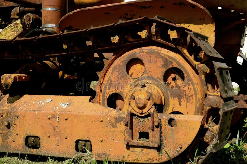 Vintage bulldozer Track. A very old vintage bulldozer with massive steel tracks is parked in a yard for display royalty free stock photo
