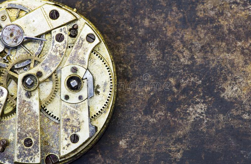 Vintage business clock close-up, time mechanism with metal gears stock images