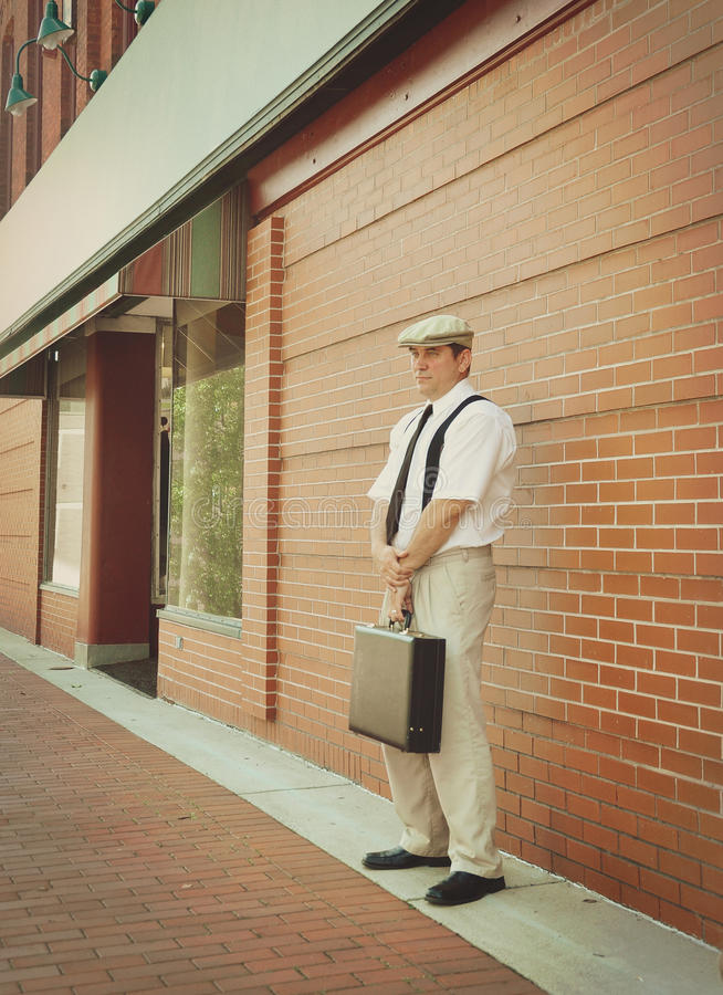 Vintage Business Man Standing Downtown by Brick Wall royalty free stock photography