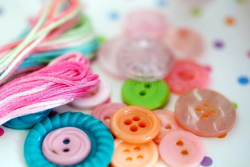 Vintage Buttons and Needlepoint Thread Closeup royalty free stock photography