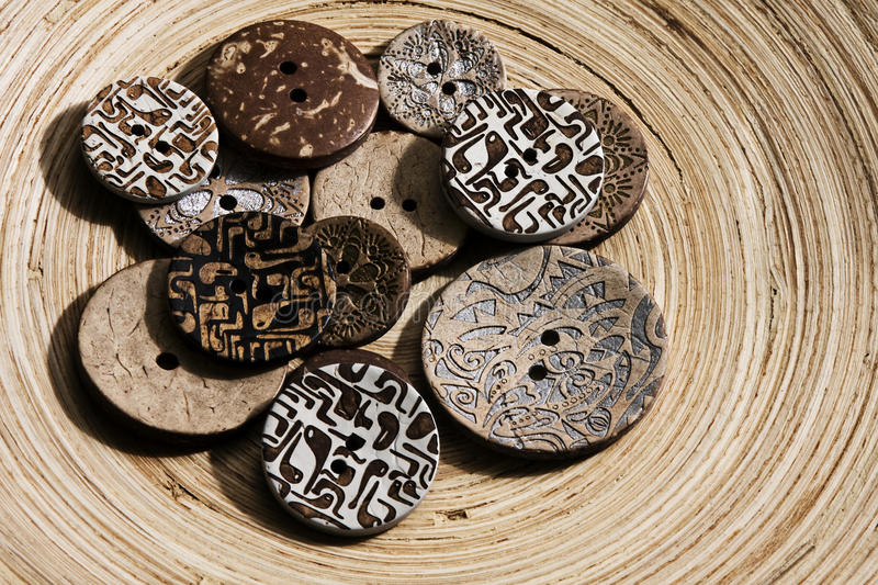 Vintage buttons on the wooden plate stock image