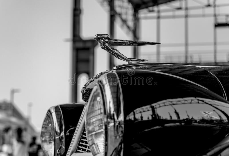 Vintage Cadillac at the American car exhibition at the Dora Publ. Black and white photograph of the car hood, the statuette and the front lights of a vintage royalty free stock images
