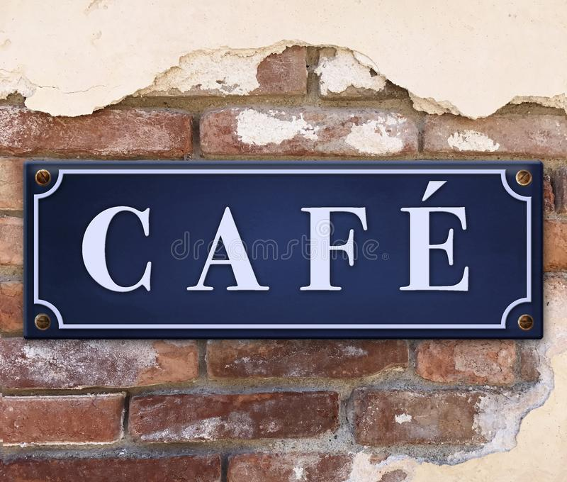 Cafe Sign on Brick Wall royalty free stock photography
