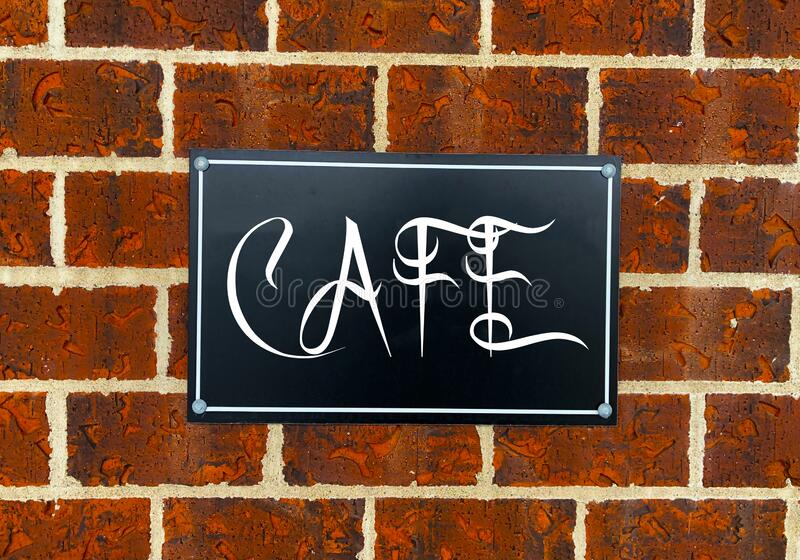 Cafe Sign on Brick Wall. Vintage Cafe Enamel Sign on Old Brick and Plaster Wall stock illustration