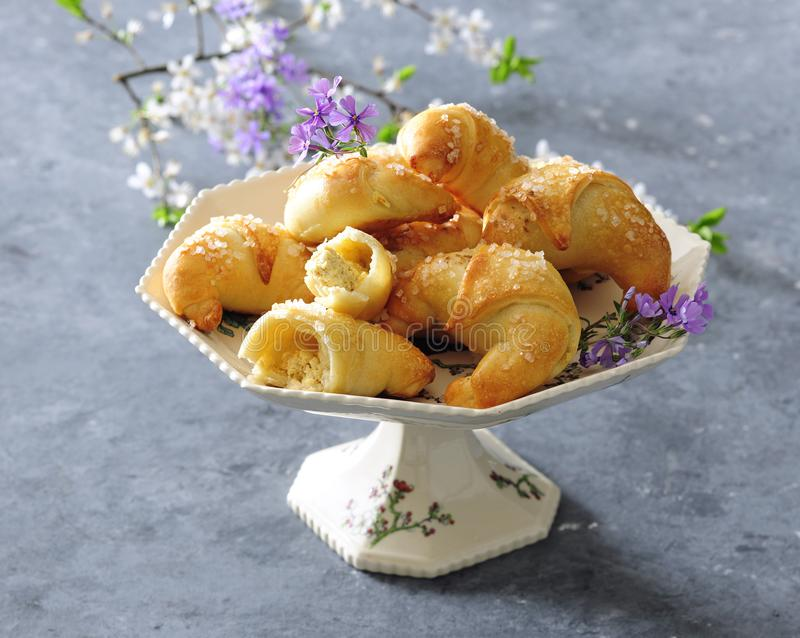 Baked puff pastry crescent rolls filled with almonds and nuts. stock photos