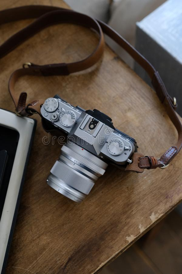 Vintage camera on brown wooden table stock image