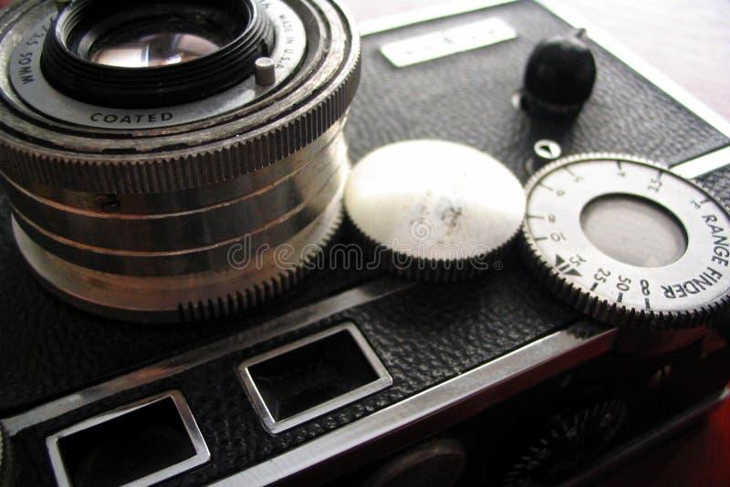 Vintage camera on cherry desk stock photos