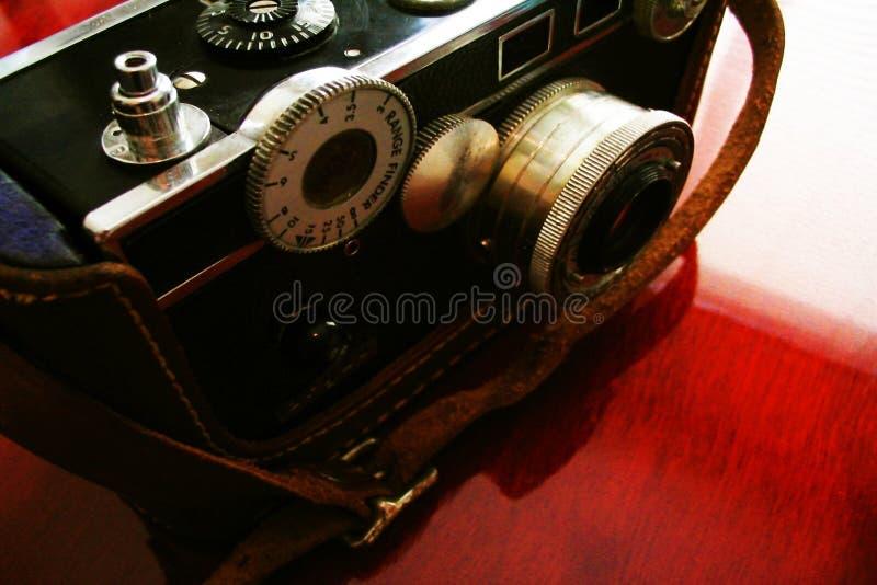 Vintage camera on cherry desk