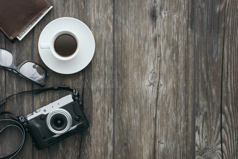 Vintage camera on a desk royalty free stock photography
