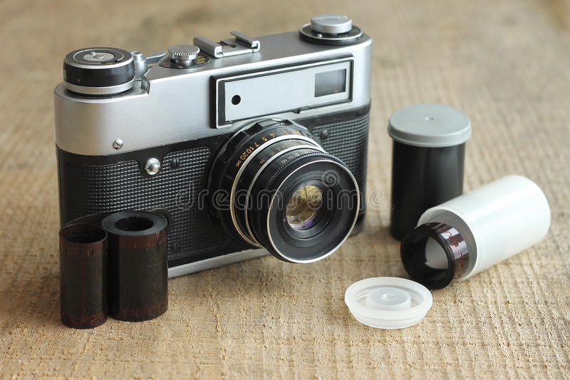 Vintage camera with film and case. Close-up stock photography