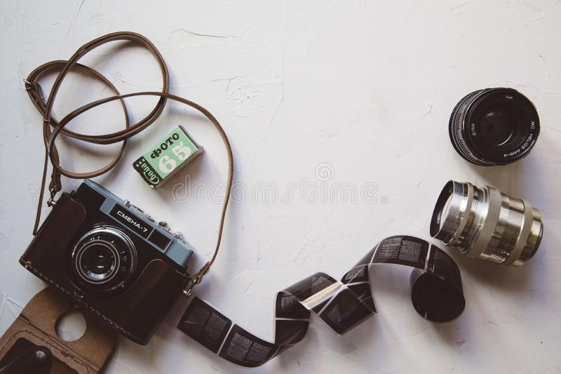 vintage camera, film, retro lenses on white table, copy space royalty free stock images
