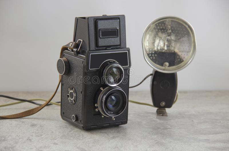 Vintage camera and flash royalty free stock photography