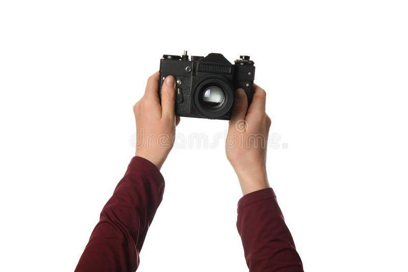 Vintage camera in hand isolated on white background. Photography and memories royalty free stock photo