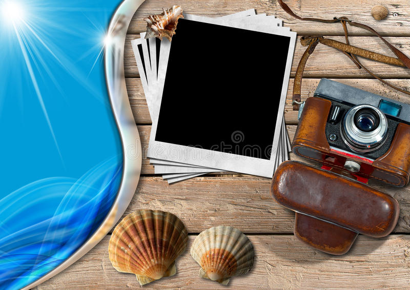 Vintage Camera with Instant Photos and Seashells. Vintage camera with leather case, a group of empty instant photos, seashells and blue sea waves, on a wooden stock illustration