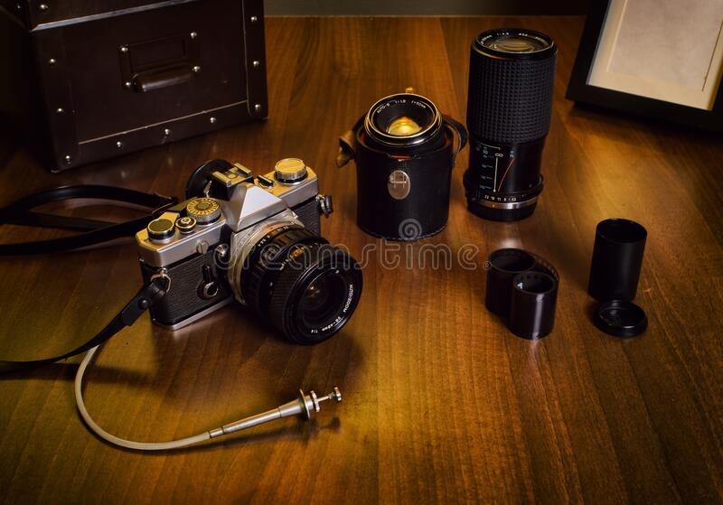 Vintage camera, lenses and box on the desk stock photography