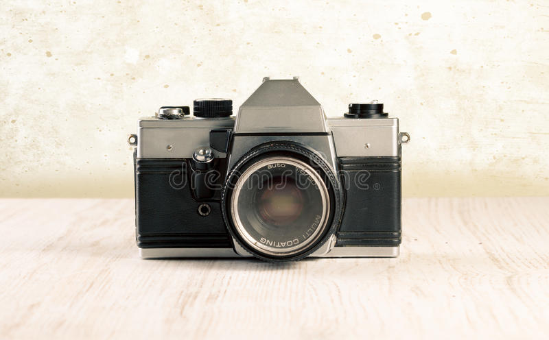 Vintage camera. Old, vintage camera on wooden background royalty free stock photos