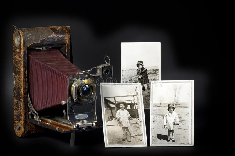 Vintage Camera & Photos. A vintage Kodak camera and photos of a young girl at different ages taken with this camera during the era of the Great Depression in the royalty free stock images