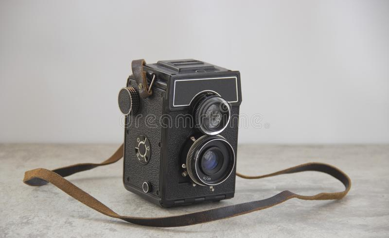 Vintage camera with strap royalty free stock images
