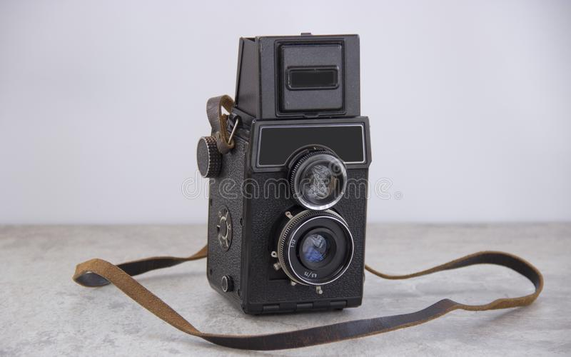 Vintage camera with strap royalty free stock photo
