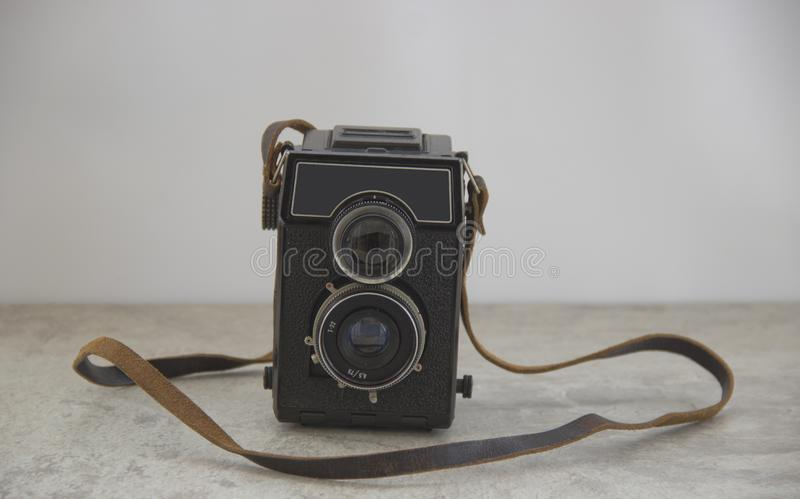 Vintage camera with strap stock photo