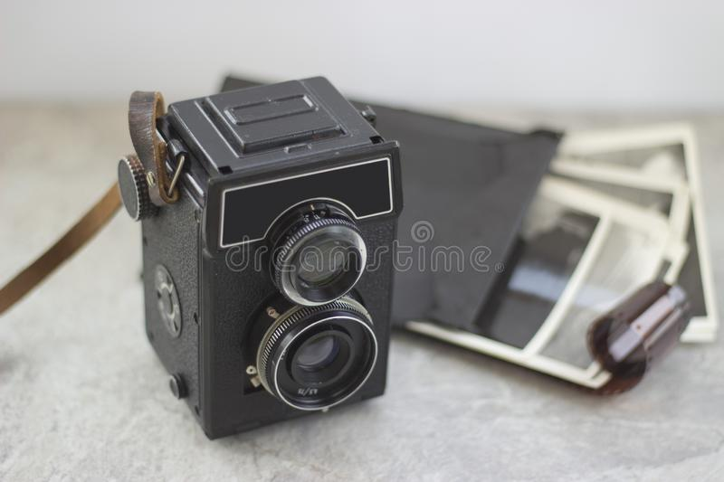 Vintage camera on the table stock photo