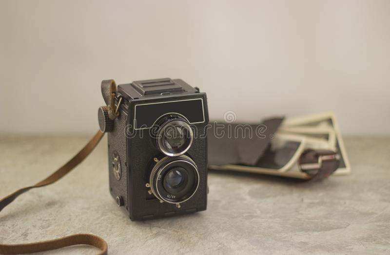 Vintage camera on the table royalty free stock images