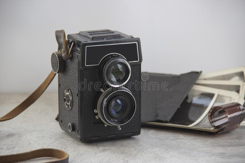 Vintage camera on the table stock photos