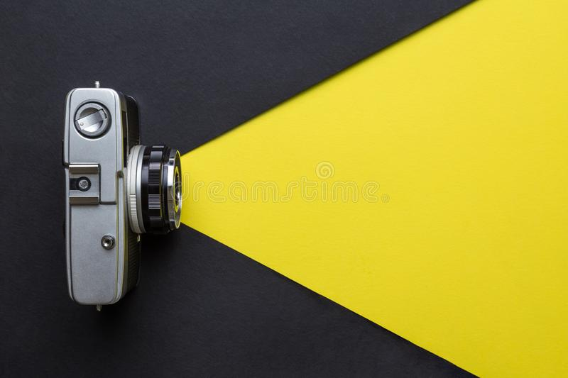 Vintage camera taking photos abstract. Photography concept. Flat lay of retro photo camera. Taking photos minimal creative concept. Space for copy stock photo