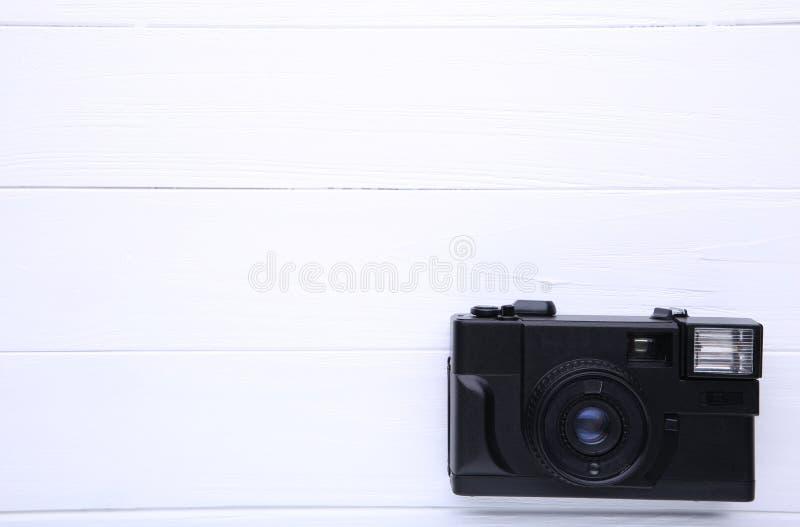 Vintage camera on white wooden background. Old photo camera on background royalty free stock photos