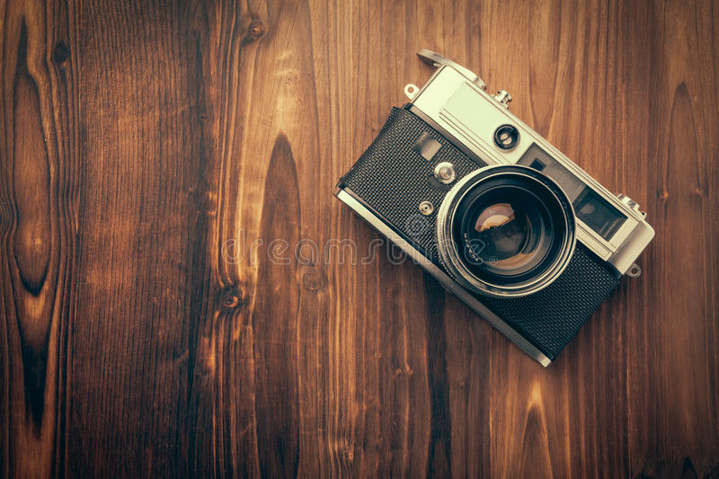 Vintage camera on wooden background royalty free stock photography